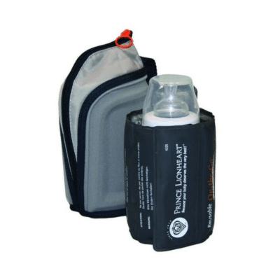 Calentador de biberones negro y gris con biberón en el interior